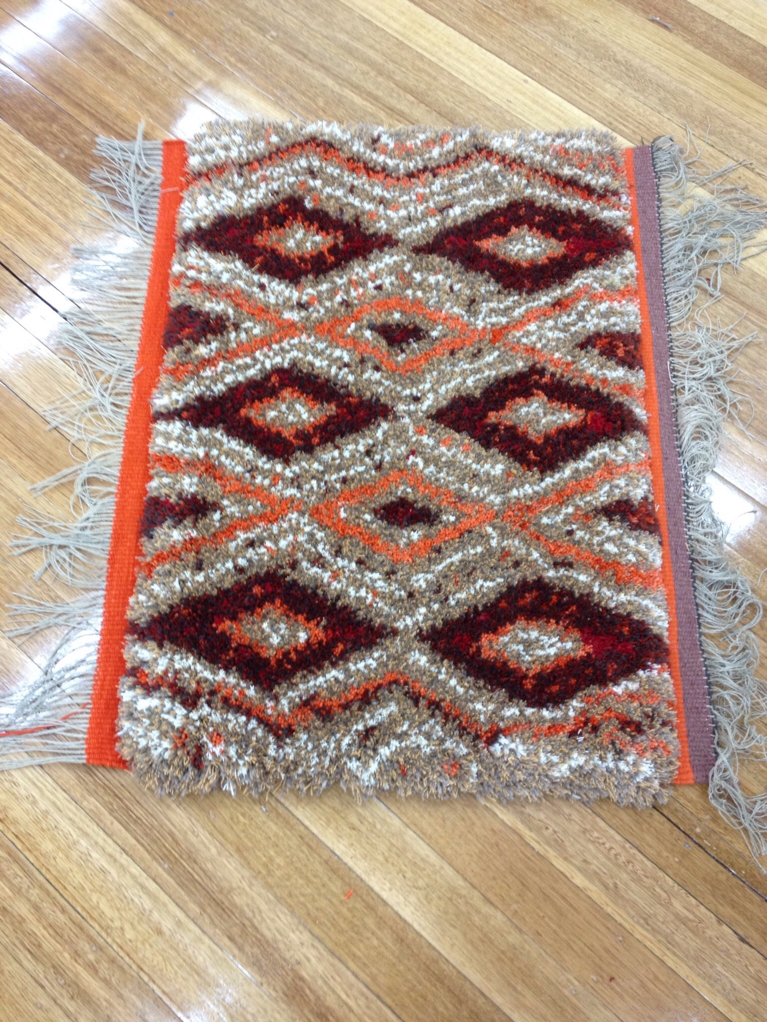 Rug off the loom, ready to do the ends.